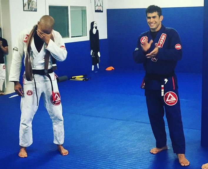 Professor Alex D'Hue being promoted to black belt by Octavio Sousa at Gracie Barra Huntington Beach