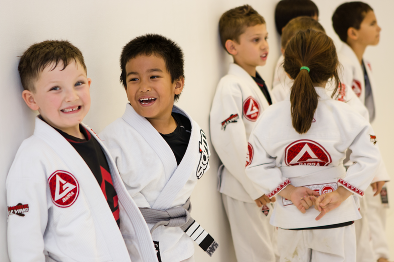 Children smiling while lined up during Little Champions class